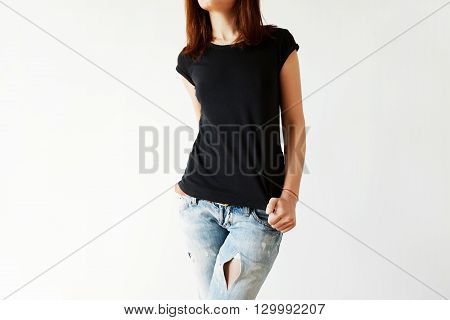 Cropped Portrait Of Young Brunette Woman With Beautiful Slim Body Wearing Black T-shirt With Copy Sp