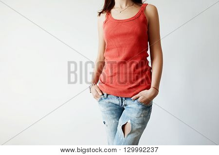 Close Up Of Stylish Red Sleeveless Top On Female With Dark Hair. Cropped Shot Of Beautiful Young Wom