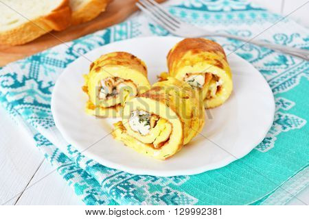 Omelette with cheese on a plate, bread, fork. Omelet recipe. Eggs recipe
