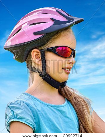 Bikes cycling child. Girl rides bicycle. Little girl in cycling. Cyclist wearing glass. Cyclist look away.