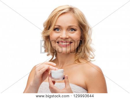 beauty, people, skincare and cosmetics concept - happy woman with cream jar