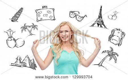 people, tourism, vacation and summer holidays concept - smiling young woman or teenage girl holding strands of her hair over touristic doodles