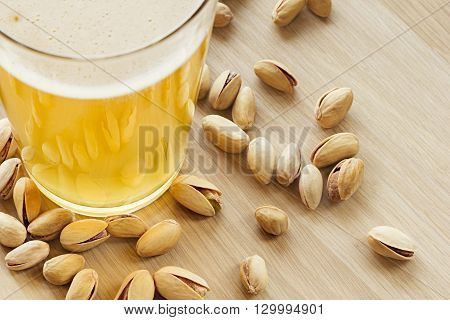 The beer with pistachios. The top view. The bar. The background.