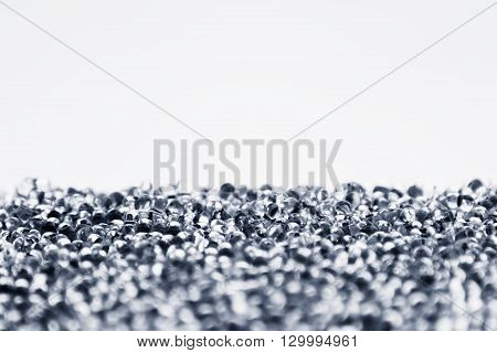 Minimalist abstract light background with transparent glass particles. The texture.