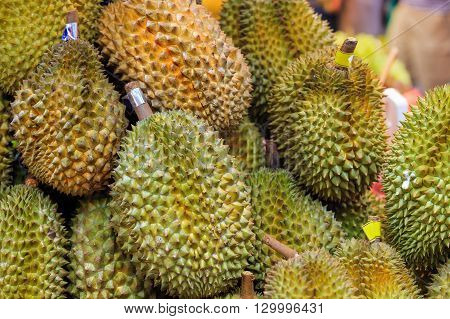 Traditional asian market stall full of fresh durians
