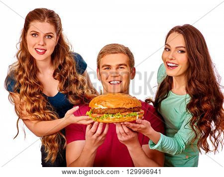 Group people holding hamburgers . Fast food concept. Happy handsome man on foreground. Women feeding man fast food. Isolated.