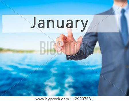January - Businessman Hand Pressing Button On Touch Screen Interface.