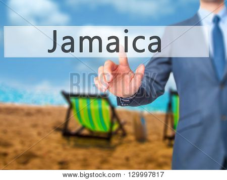 Jamaica - Businessman Hand Pressing Button On Touch Screen Interface.