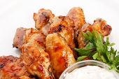 stock photo of baste  - Chicken wings with sauce - JPG