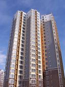 image of row houses  - new flats building under blue sky highrise - JPG