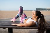 Fitness Woman Doing Crunches At The Beach poster