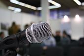 picture of public speaking  - microphone in auditorium - JPG