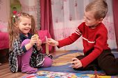 foto of playing card  - two children play cards in playroom - JPG