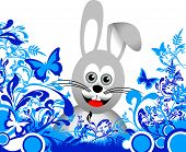 foto of rabbit hutch  - a grey easter bunny on a floral foreground - JPG