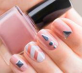 Nail art manicure. Fashion modern design Beige color Manicure with metal accessories. Bottle of Nail poster