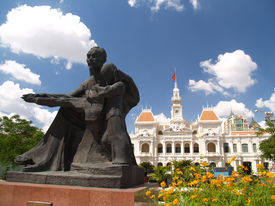picture of city hall  - a statue of ho chi minh infront of a city hall building - JPG