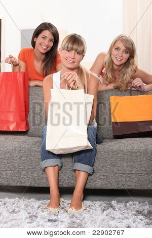 Three  woman, holding shopping bags