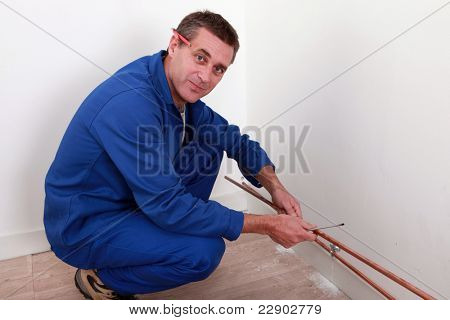 Plumber fixing copper piping