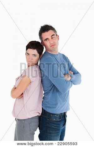 Couple angry at each other standing back to back