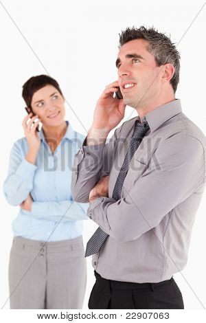 Portrait of managers making a phone call against a white background
