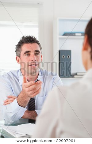 Portrait of a manager talking to a candidate in his office