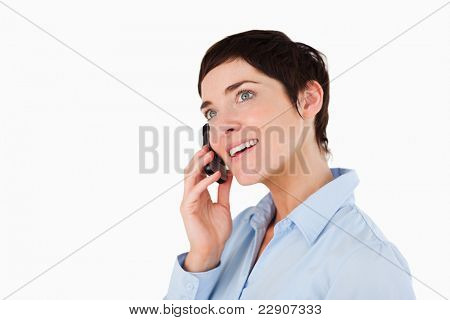 Close up of a businesswoman making a phone call against a white background