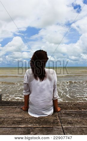 Woman Sit On The Jetty