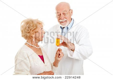 Pharmacist giving dosage instructions to an attractive senior patient.  Isolated on white.