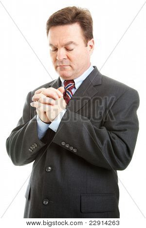 Businessman or minister with hands folded in prayer.  Isolated on white.