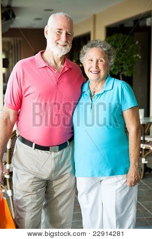 Portrait of cute senior couple on a shopping trip.