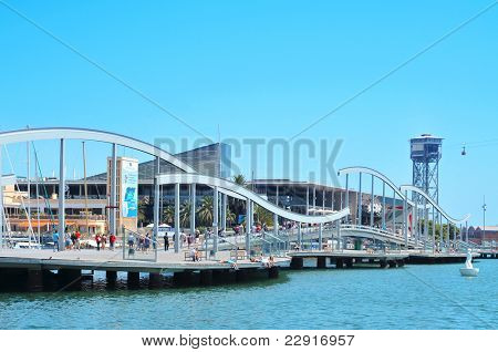 BARCELONA, SPAIN - AUGUST 16: Rambla de Mar and Port Vell on August 16, 2011 in Barcelona, Spain. The area has a leisure center, shops and restaurants called Maremagnum, an IMAX cinema and an aquarium