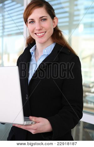 A pretty young business woman with a laptop computer