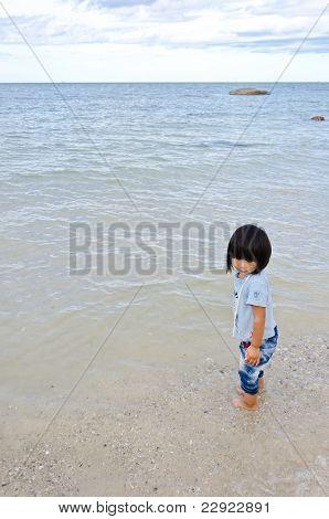 Little Asian Girl At The Beach