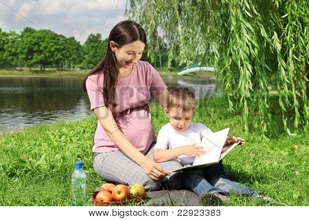 Mother Reading Picture Book To Her Child
