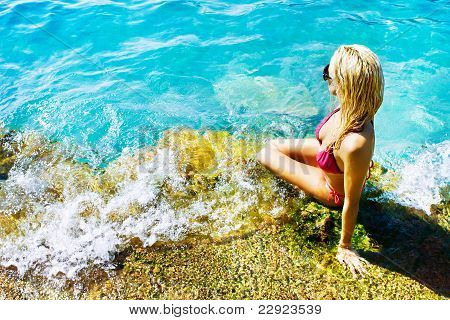 Young Attractive Woman Near The Water
