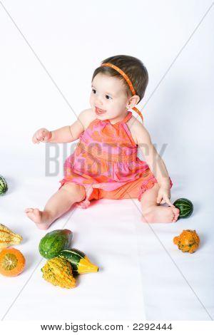 Girl With Pumpkins (2)