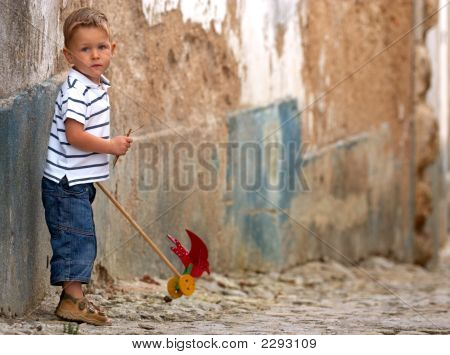 Little One With Handmade Toy