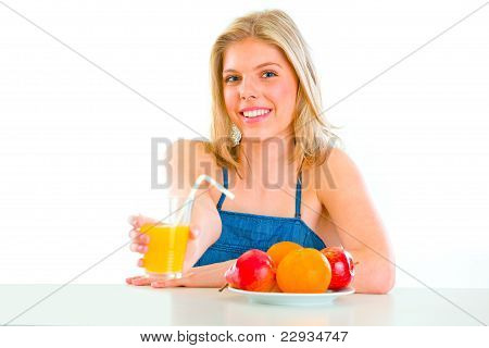 Smiling Beautiful Girl Giving Orange Juice