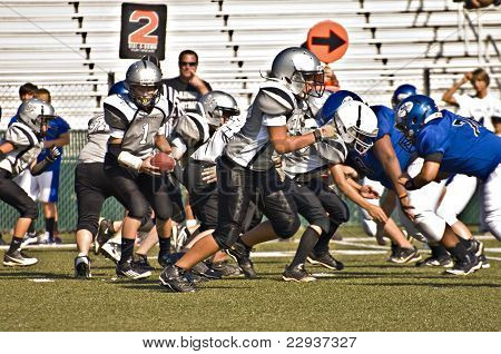 Little League Football Blocking For The Play