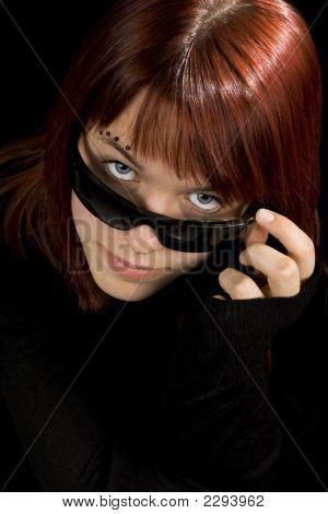 Girl Looking Through Sunglasses.