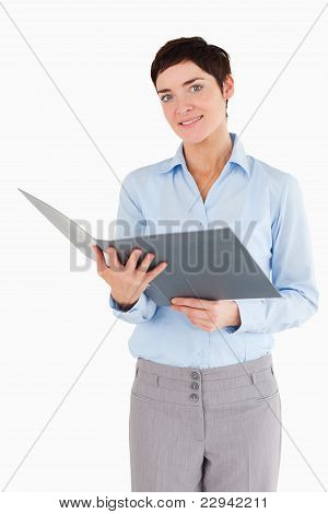 Portrait Of A Businesswoman Holding A Binder