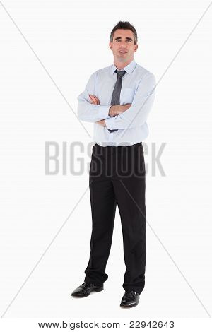 Businessman Standing Up With His Arms Crossed