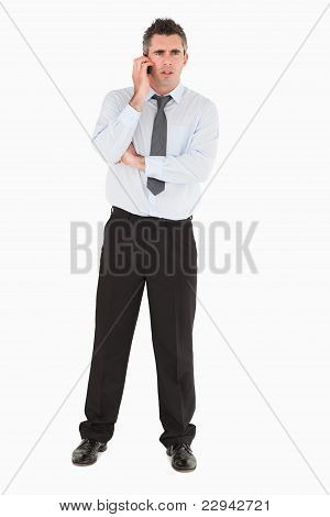 Angry Businessman Using A Mobile Phone