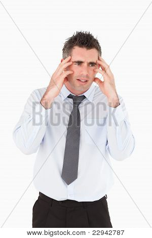 Portrait Of A Sad Businessman With His Hands On His Temples