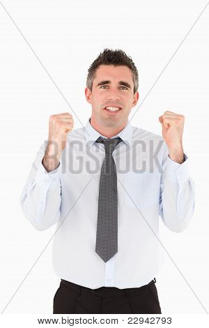 Portrait Of A Cheerful Businessman With The Fists Up
