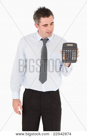 Accountant Looking At A Calculator