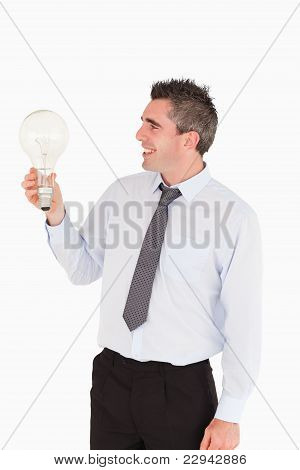 Businessman Looking At A Light Bulb