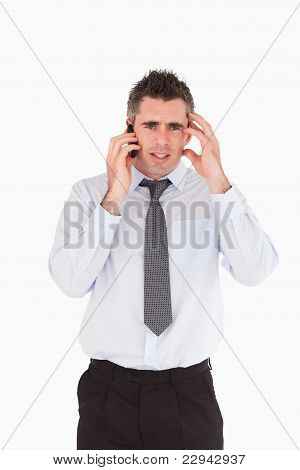 Portrait Of A Sad Man Making A Phone Call