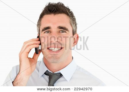 Close Up Of A Happy Businessman Making A Phone Call