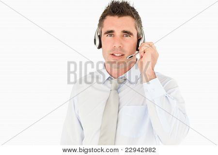 Male Secretary Speaking Through A Headset